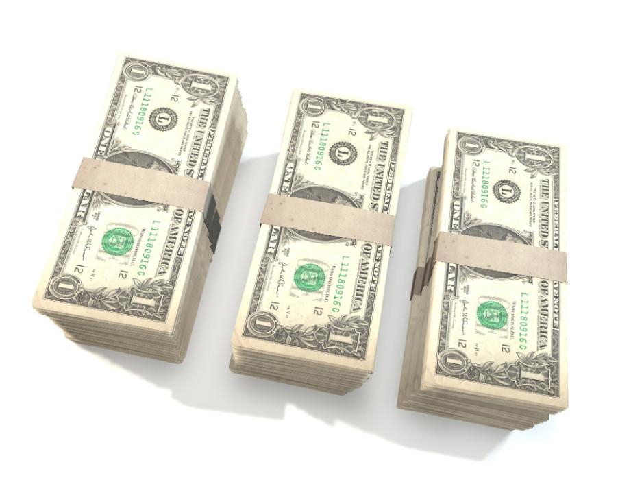 Three stacks of one dollar bills