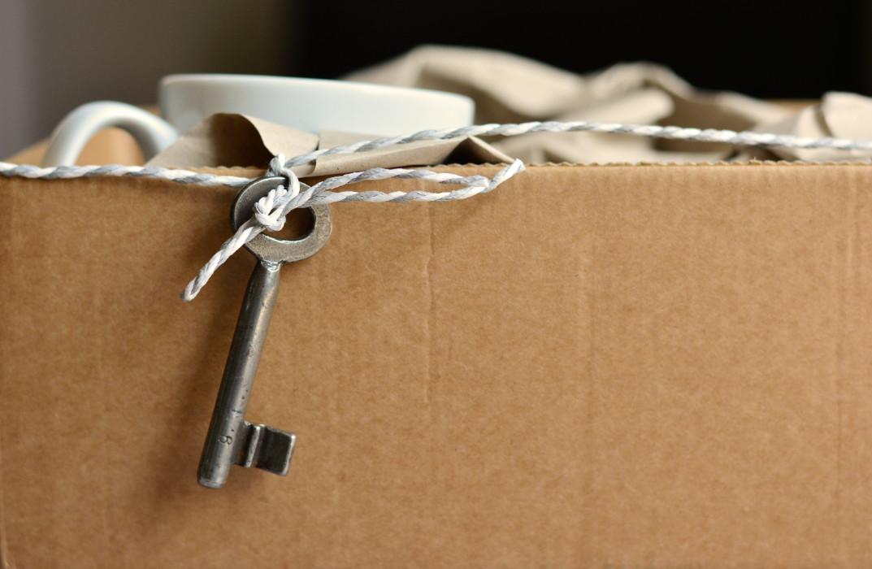 Metal key on carboard box